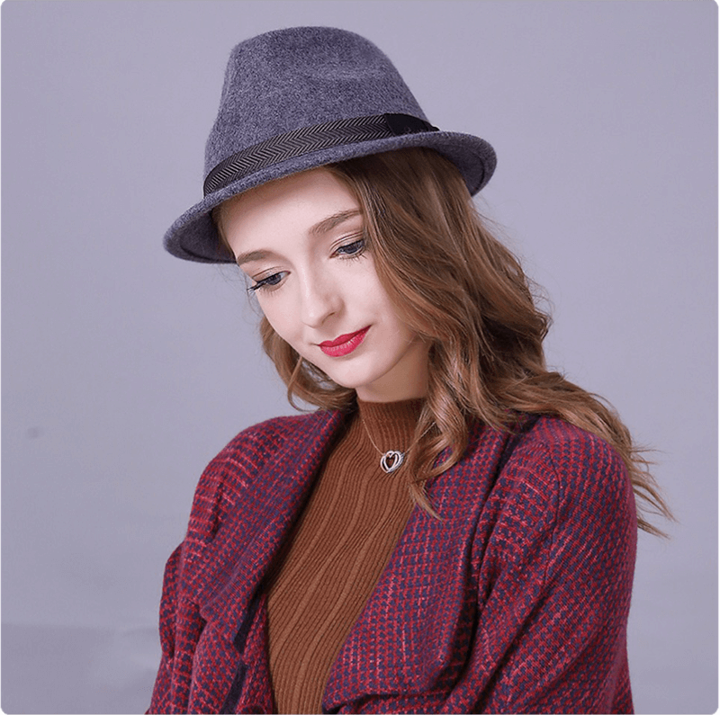 Model with our illusion trilby facing down