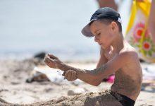 Boy washing body instead of cap